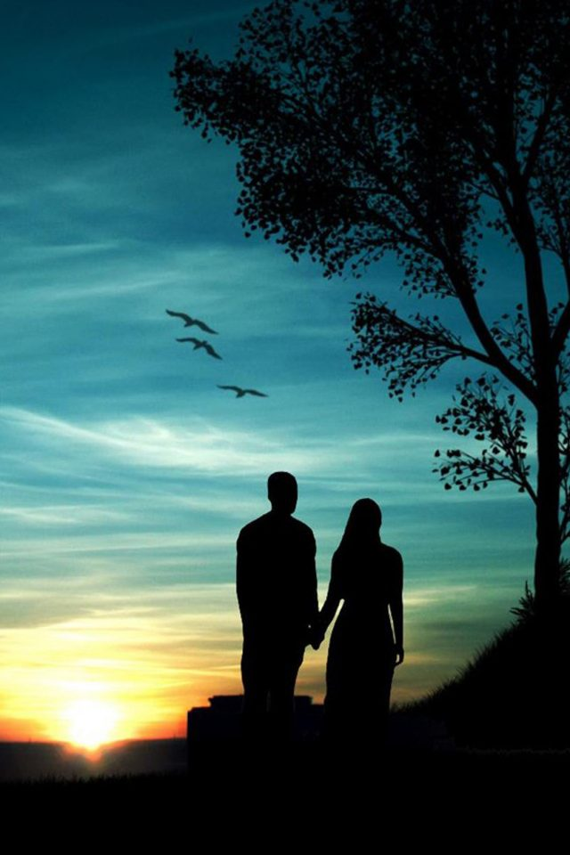 Couple at Sunset Android wallpaper
