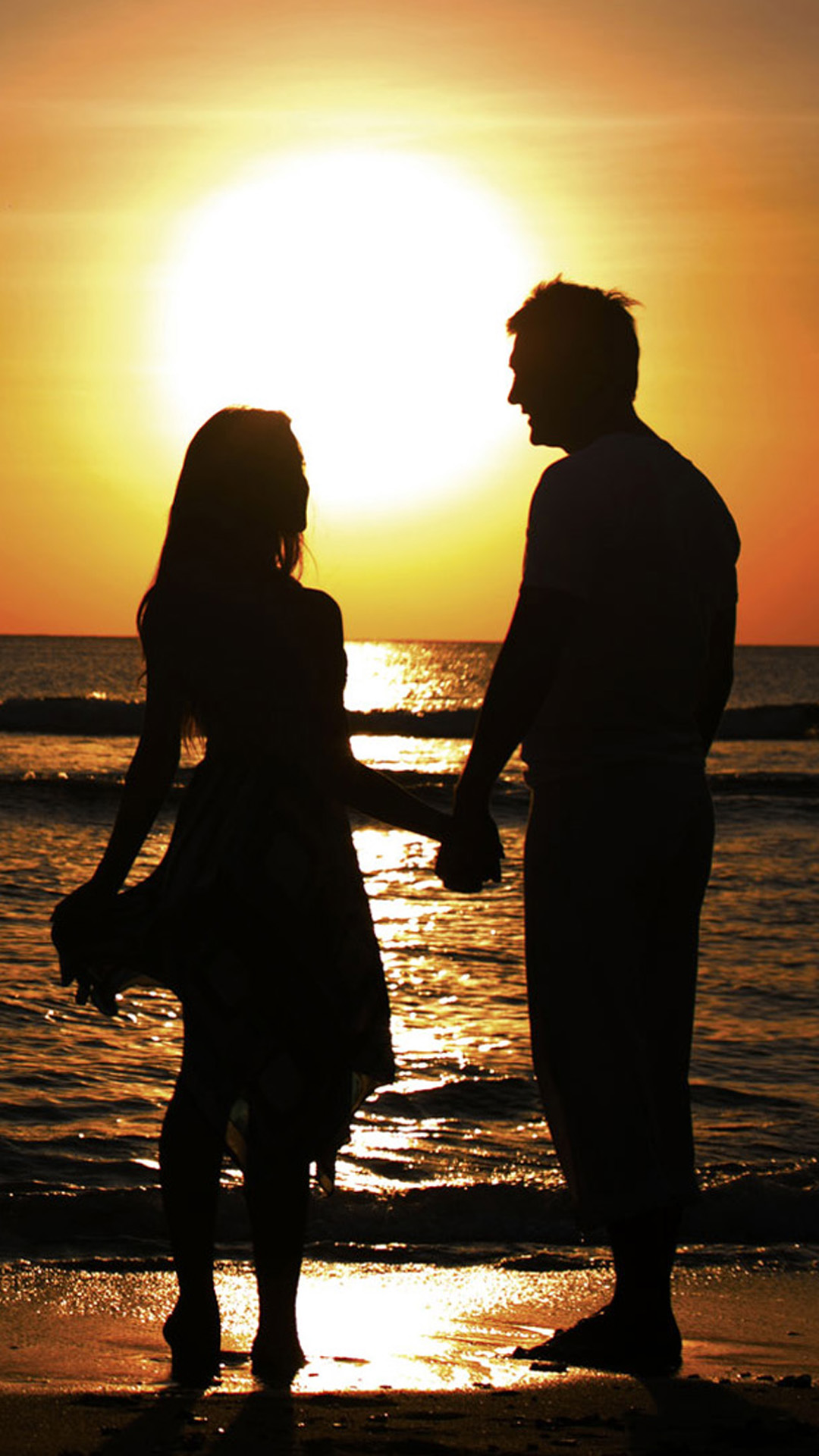 Sunset Beach Couple Android wallpaper